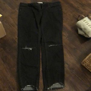 Ripped frayed bottom black jeans
